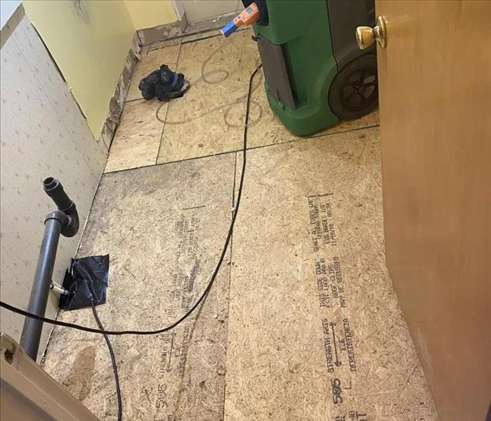 New subflooring is placed in a bathroom.