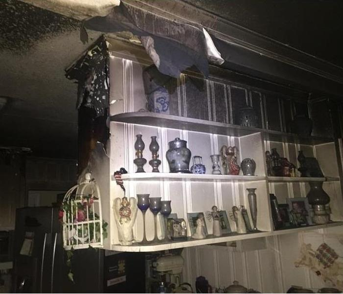 Burned Shelving and cabinets in the kitchen